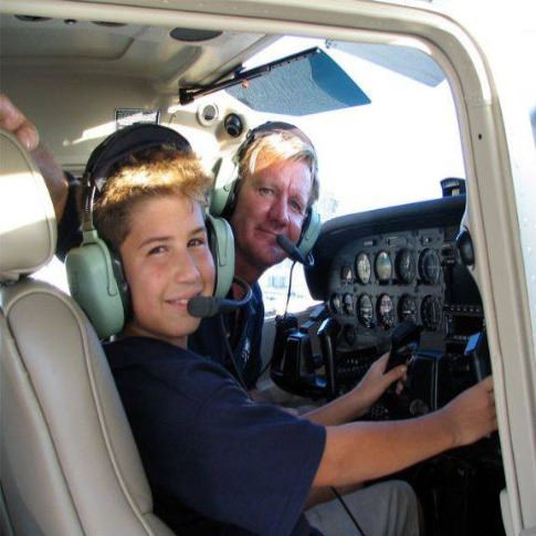 Pilot and Kid in Plane