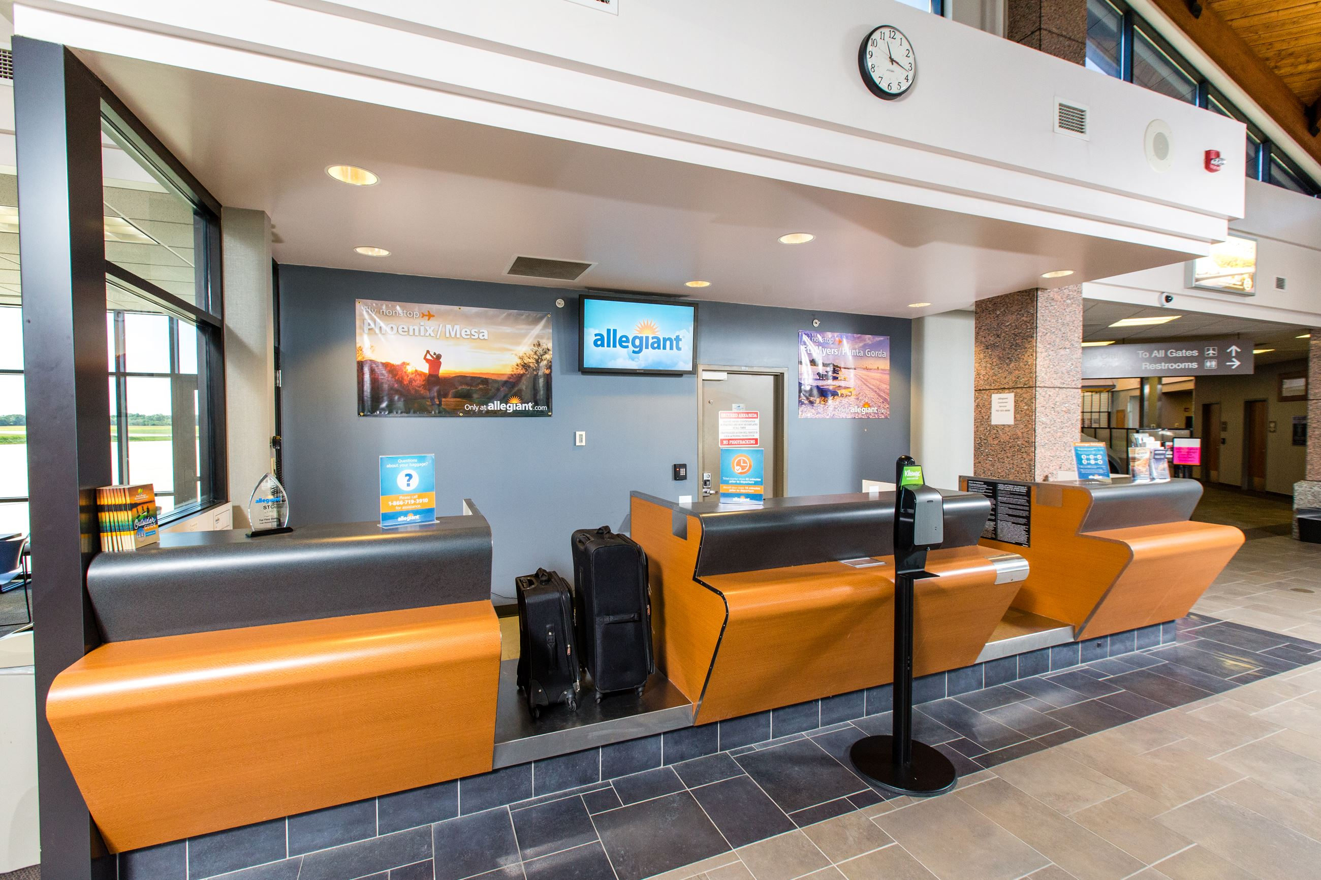 Allegiant ticket counter with bags