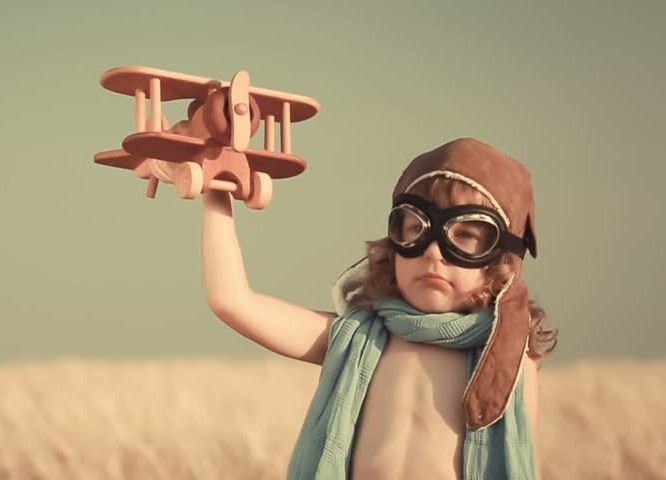 child flying airplane
