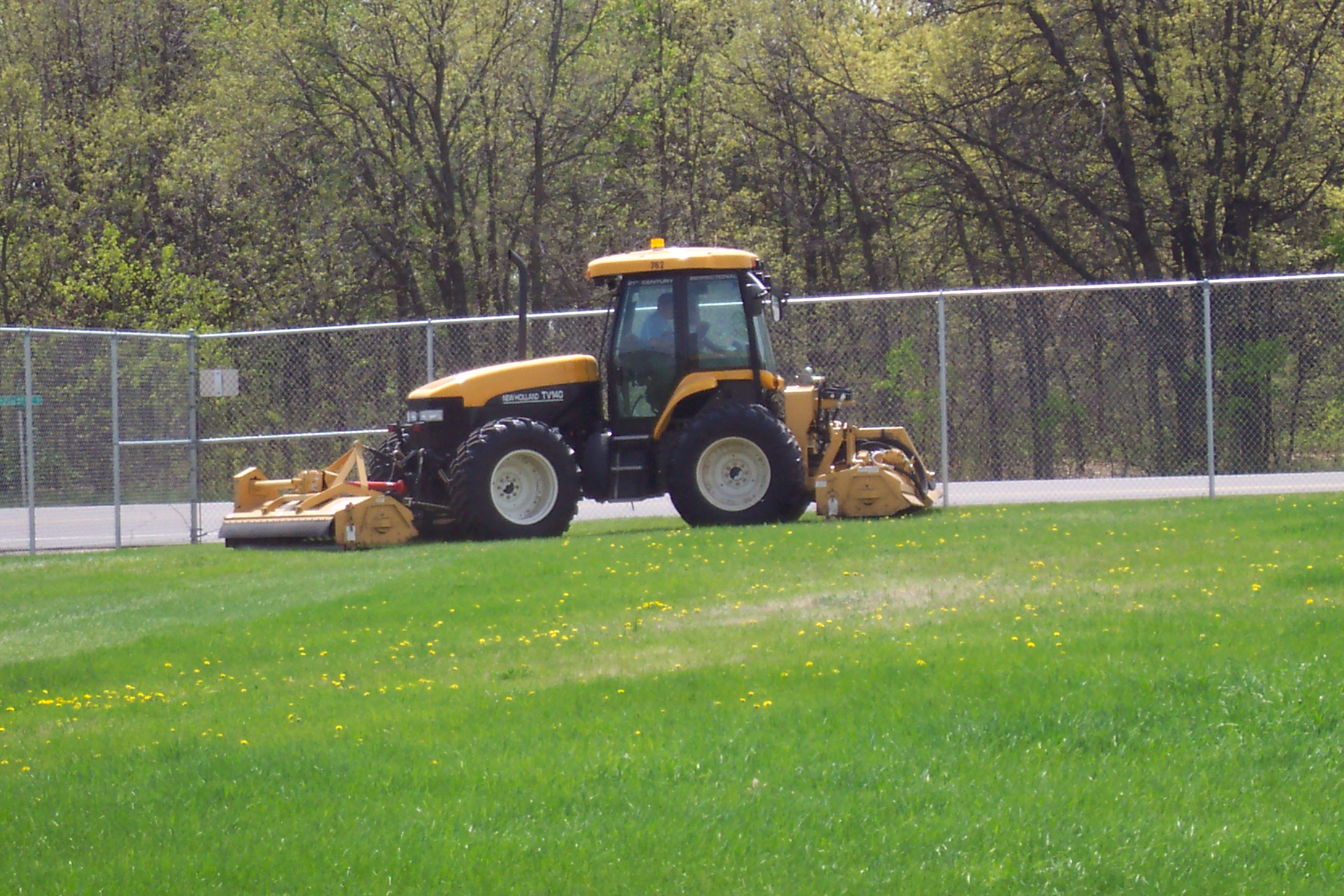 New Holland Tractor mowing
